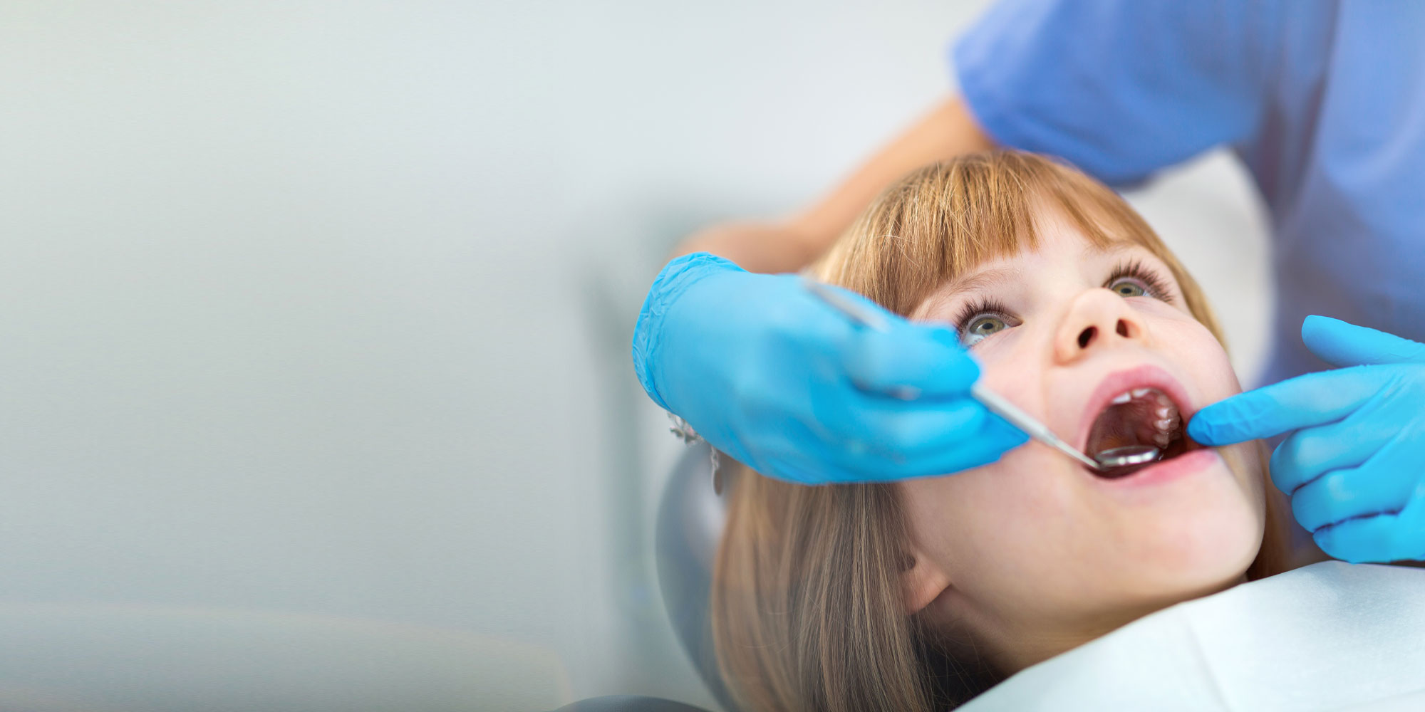 young dental patient undergoing procedure